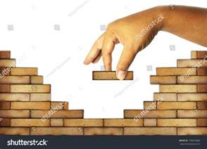 Building A Wall hand building a brick wall build a house concept stock photo