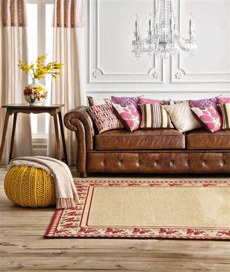 throw pillows for tan couch tan leather chesterfield sofa with pink and brown cushions