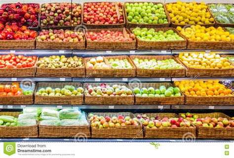 Shelf Of Oranges by Fresh Fruits And Vegetables On Shelf In Supermarket Stock