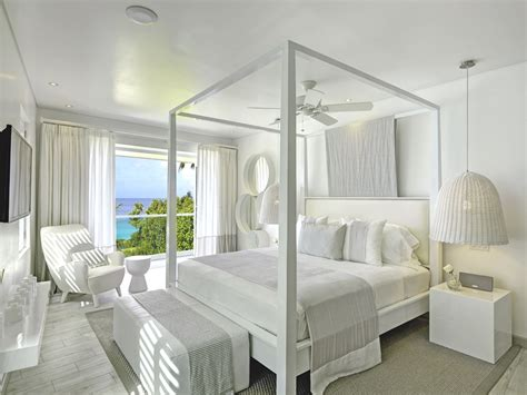luxury white interiors ice white design designer uncovered luxury barbados home footprints by kelly hoppen mbe