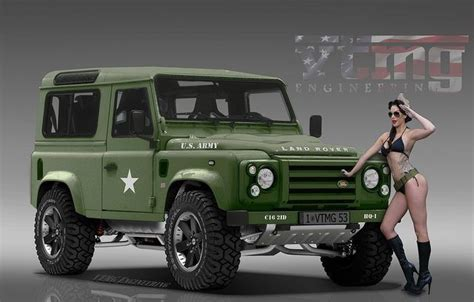 navy range rover military ladies posing with green land rover defender