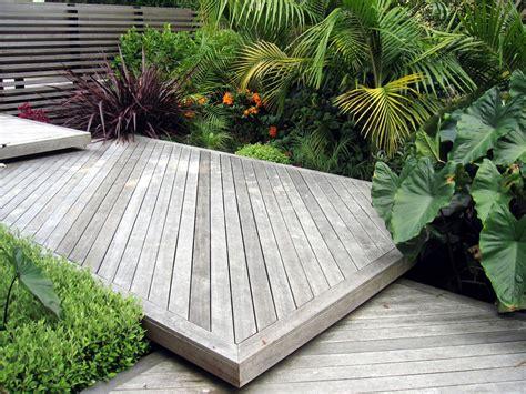 stepped garden design ideas stepped decking screen and sub tropical planting design