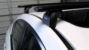 mazda 3 sedan with thule 460r podium black aeroblade roof