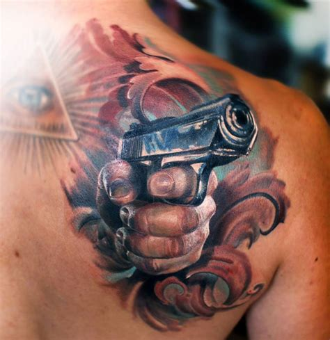 shoulder blade tattoos designs gun shoulder blade design best design ideas