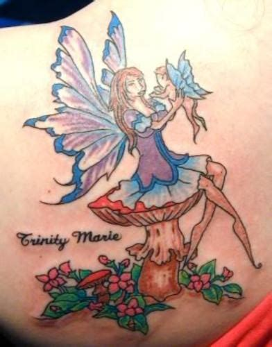 sitting fairy tattoo designs colored flowers and sitting on