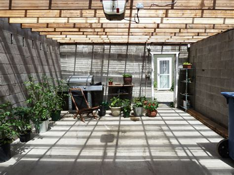 Greenhouse Garage by An Battered Calgary Garage Is Transformed Into A