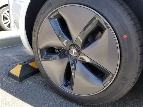 white tesla model 3 aero wheels teslarati com