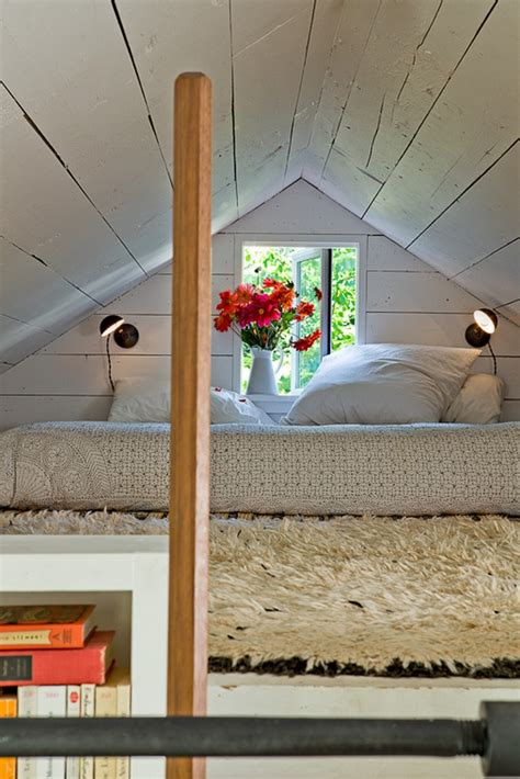 bedroom with loft exploiting the spaces of small house with loft home