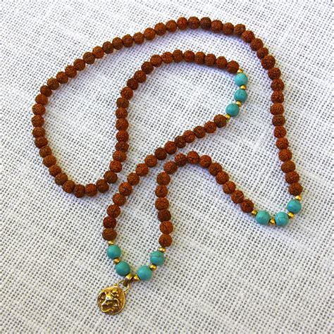 ganesh mala rudraksha and turquoise ganesh 108 mala honoring the sacred
