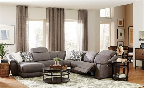 neutral transitional family room with curved sofa and neutral great room with 6 pc vegara pewter sectional