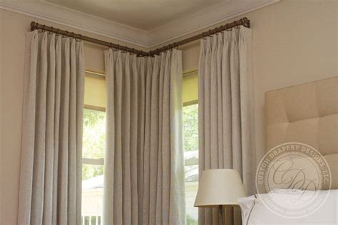 corner window curtain pole window treatments with two windows in a corner drapery