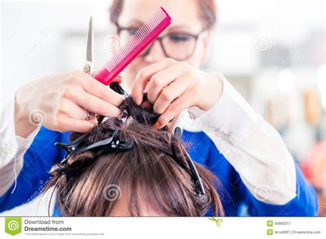 great clipes styling for women hairdresser styling woman hair in shop stock photo image