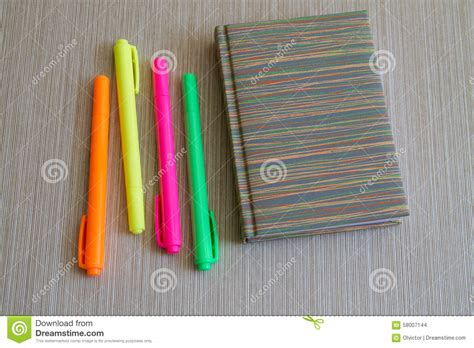 crayons colored pencils coloring book four books note book and four colored markers stock photo image