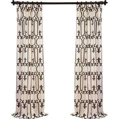 trellis print curtains frame a window in your master suite or office with this