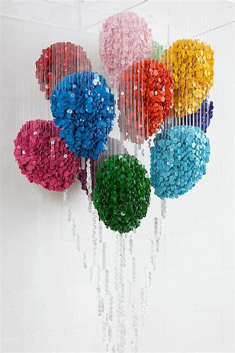 Button Painting spatial sculptures using colorful suspended buttons my modern met
