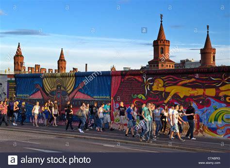 berlin wall mural in front of berlin wall mural east side gallery berlin stock photo royalty free image
