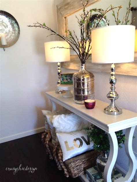 home goods entryway table for a clean sophisticated look try pairing items like