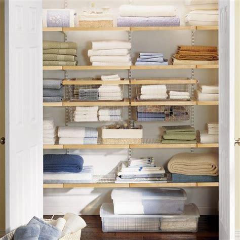 white elfa d 233 cor deluxe closet the container store container store linen closet my organized linen closet