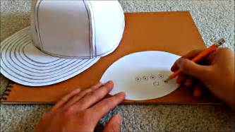 Tutorial on how to make a flat brimmed paper hat new era style