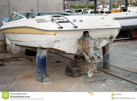 old boat engine repair old speed boat on maintanence wooden logs stock photo