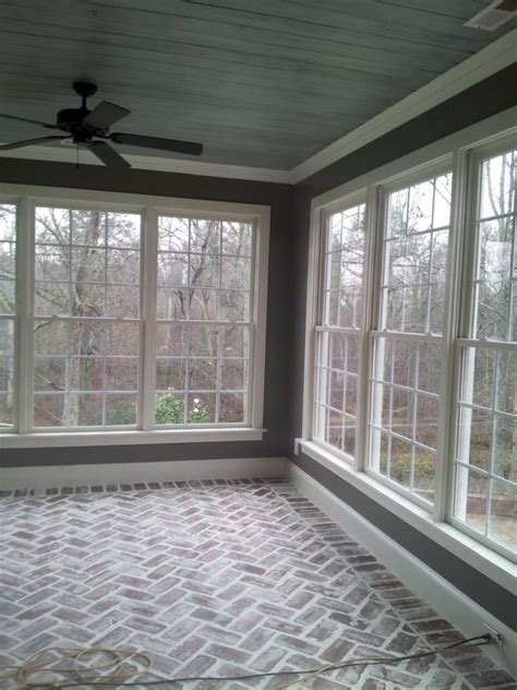 sun room reclaimed 100 yr old brick laid in a herringbone pattern antiqued quot haint quot blue