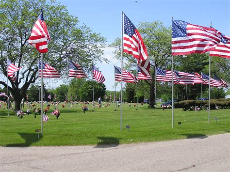 Sunset Memory Gardens by The Annual Memorial Day Avenue Of Flags Ceremony At Sunset