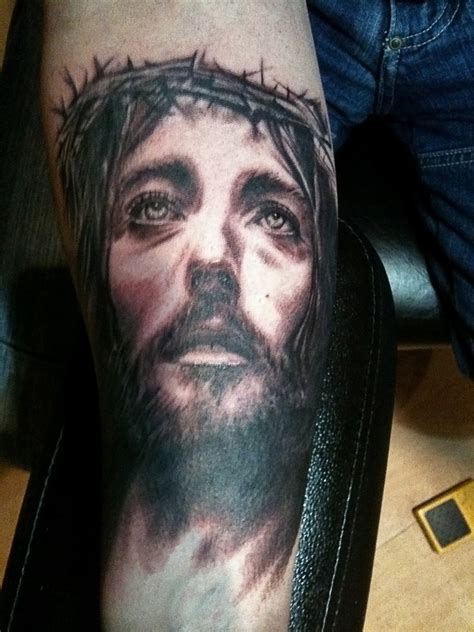 jesus tattoo on arm 50 jesus tattoos for the faith sacrifices and strength