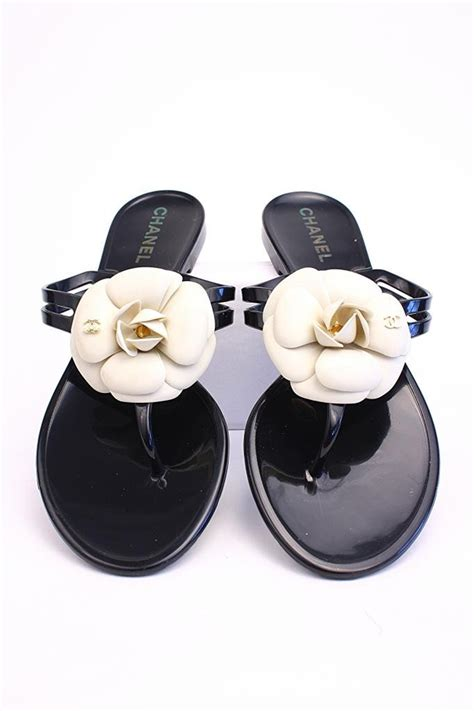 chanel black sandals w white camellia flowers at rice and