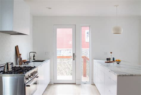 demode kitchen transformed into bright white modern space