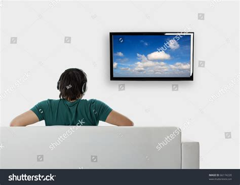 couch free tv rear view young man seated on stock photo 66174220