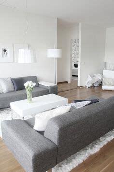 dark floors grey couch white rug white walls google