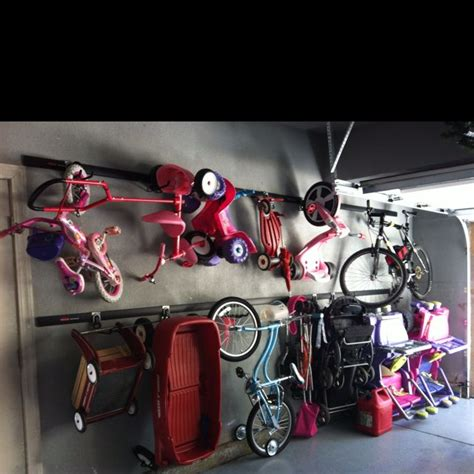 garage toy storage stroller bike ride on toy storage solution we installed