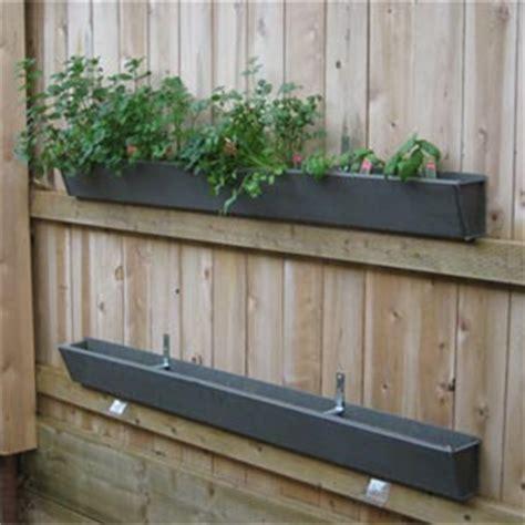 Gutter Planters On Fence by Diy Gutter Garden