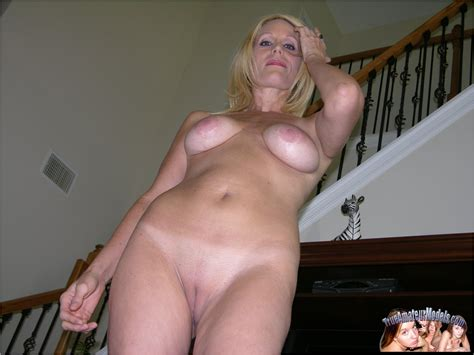 amateur blonde over 50 strips naked and exposes her big