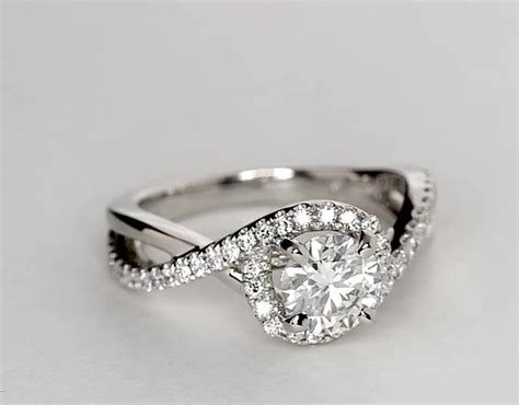 twisted halo engagement ring in 14k white