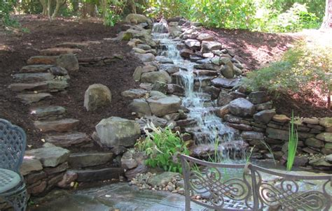 steep backyard solutions how to enhance your yard through stone steps and pathways premier ponds
