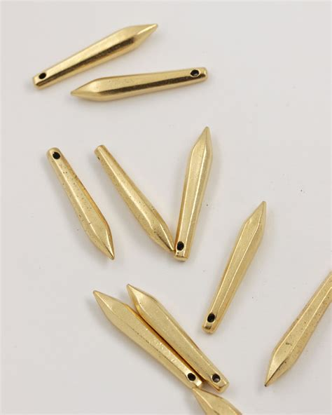 faceted bead metal teardrop pendant metal faceted teardrop pendant 37x6mm sold individually