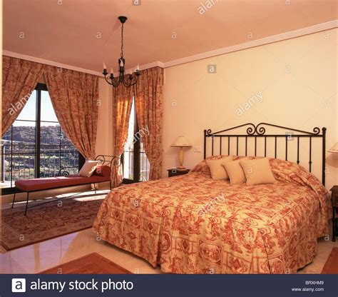 what is bed in spanish toile de jouy quilt on wrought iron bed in spanish bedroom with stock photo royalty