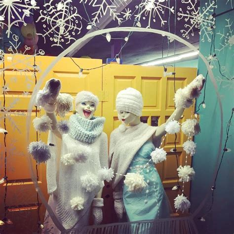 whimsical winter window display snow globe window