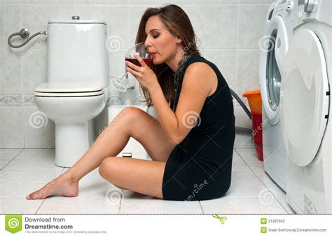 women in the bathroom woman drinks wine in her bathroom stock photo image