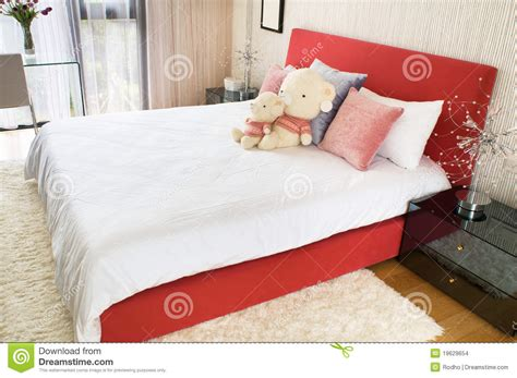 bedroom with toys on the bed stock images image