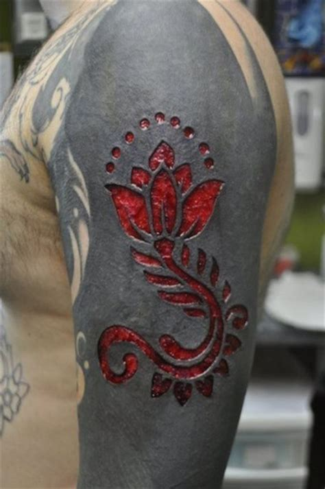 scar flower on blackwork tattoo best tattoo ideas gallery