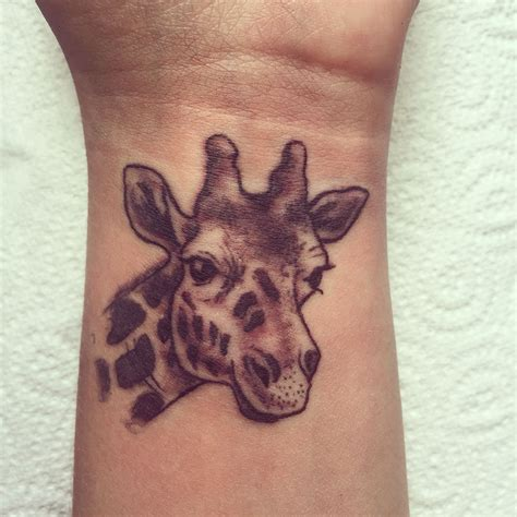 girly wrist tattoo small girly giraffe on wrist in black and white