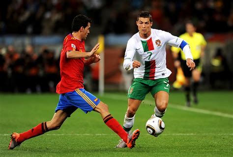 spain vs portugal world cup cristiano ronaldo and sergio busquets photos photos