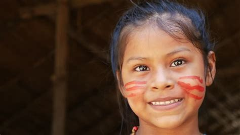 hd stock video footage two women flaunt tradition and cute native brazilian girl at an indigenous tribe in the