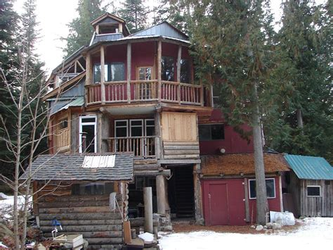 hippie house idaho hippie house 3 stories built on tree trunks photograph by windy mountain