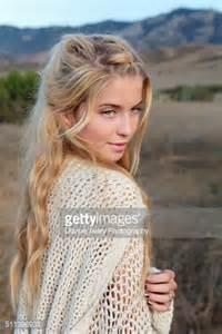 beautiful teen beautiful teen looking over shoulder stock photo getty