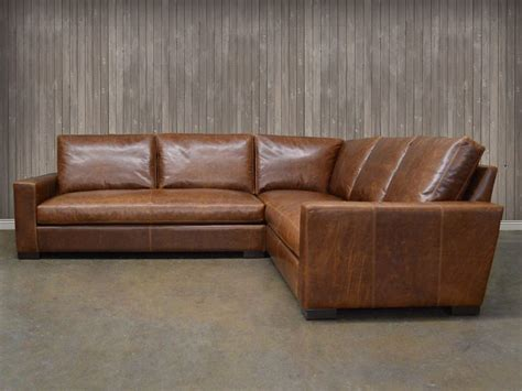 1 lovely tan leather sectional sofa with chaise lounge