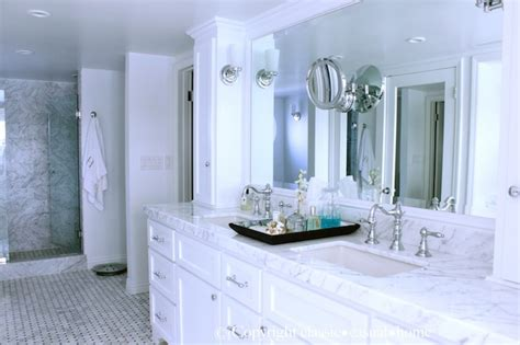 white marble countertops  white cabinets traditional