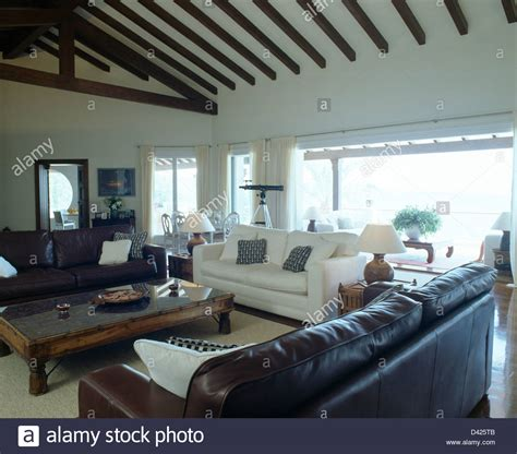 living room with white leather sofa brown leather sofas and white sofa in modern coastal